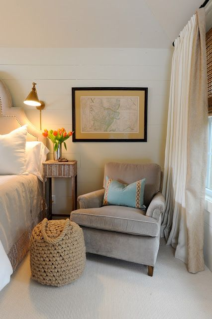 A cozy club chair adds warmth to a master bedroom. Chair on one side and small table. or rocking chair for mom.