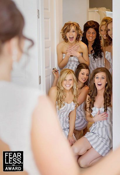 Do a First Look with the bridesmaids! Very cute wedding photo idea. The photos you get to go back and look at after will make you smile for years.