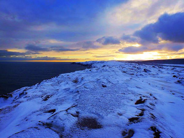 Where The Sky Meets The Sea by Zinvolle - Beautiful sunset at Cape Spear after the first snowstorm of this year.