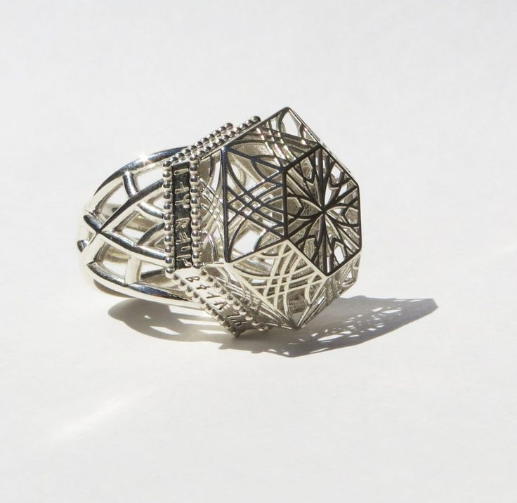Beauty Ring by I Am Rock. This sacred geometry inspired diamond ring bears a medieval runic inscription translating to beauty is the light in your heart. Live with passion, love wholeheartedly, give without agenda. These are some of the things that will always be in fashion. Gift this ring to someone who is beautiful.