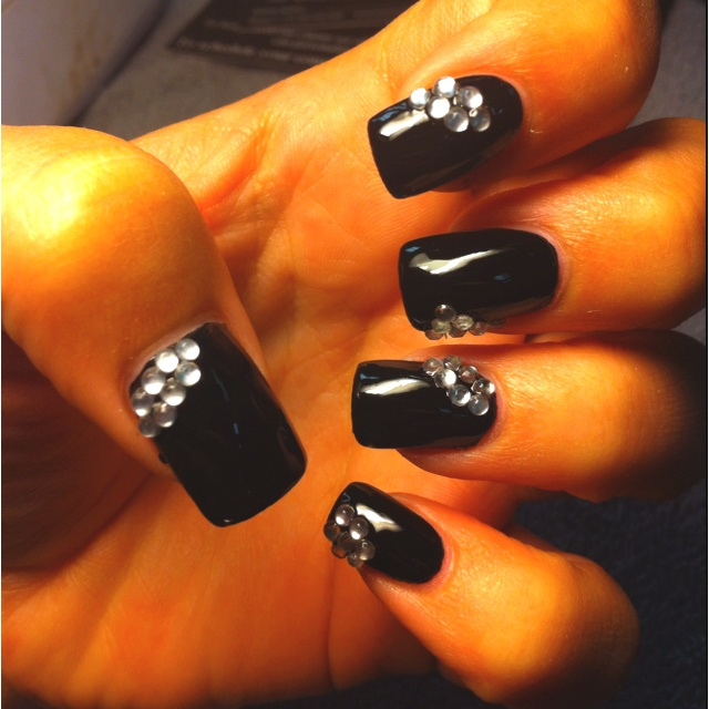 I never want to change my nails!! Lady Gaga nail polish from NYC! #black #rhinestone #nails
