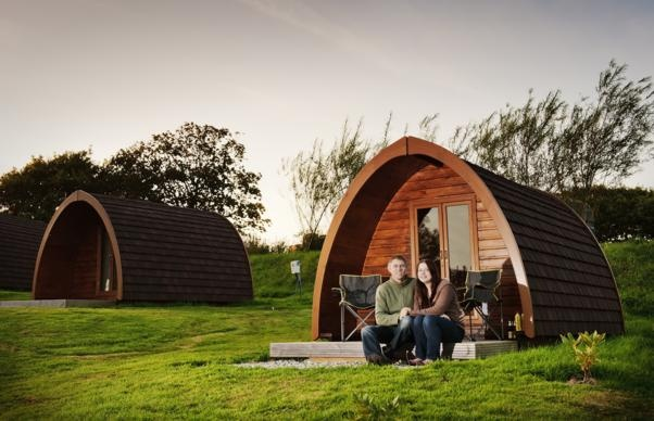 Young couple enjoying their holiday in a camping pod at Meadow Lakes, Cornwall