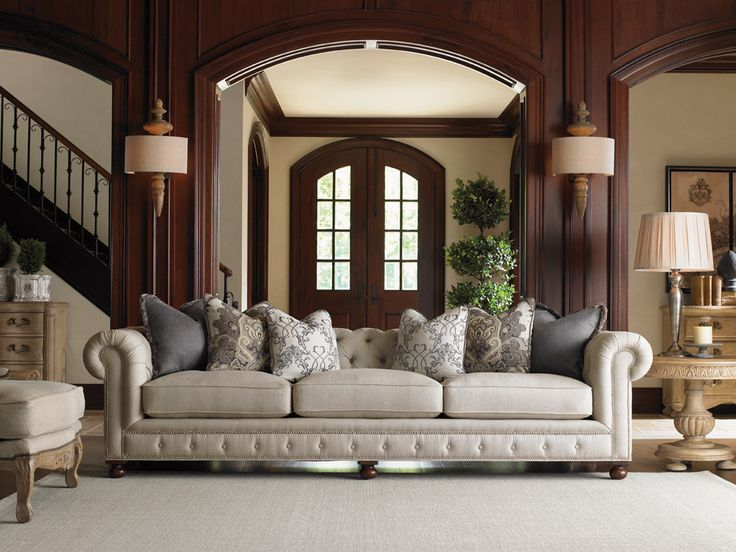 Tufted sofa with roll arms and beautiful bun feet by Lexington Home Brands