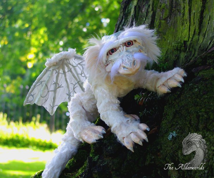 My latest art doll: a moon dragon  Fully posable, even wings, and every claw can be posed indivdually. He can blink with his eyes as well.