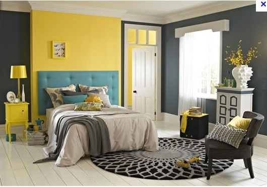 unusual yellow feature wall with grey + teal bedroom - but it