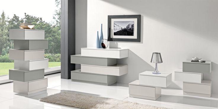 Bridge di Giessegi è un comò laccato opaco nelle tenue tonalità del grigio…