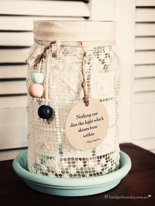 Create a beautiful vintage lace lantern using a glass jar, Mod Podge, lace, ribbon and beads.