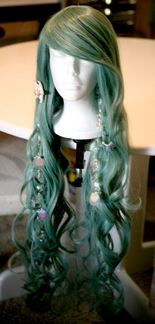 "DIY mermaid hair extensions. fishing line, iridescent ""bubbles"" (large-flat-sequins, vary sizes) varying size pearl beads, maybe a few gold or silver filler beads, hot glue, star fish, hair clip. String accessories on fishing line, tie and knot onto clip, dab of hot glue for extra hold, hot glue star fish onto clip covering string, clip in!"