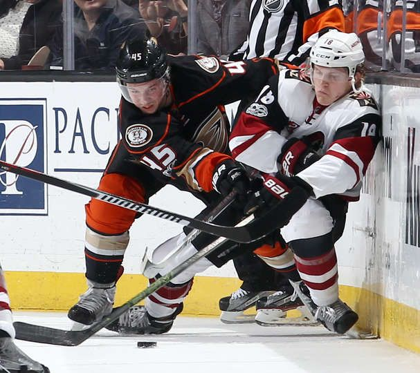 Sami Vatanen 45 of the Anaheim Ducks battles for the puck against Christian Dvorak 18 of the Arizona Coyotes