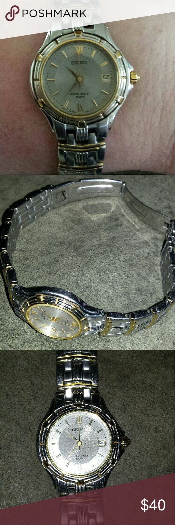 Small ladies Seiko water resistant watch This petite two tone watch features a second hand and date window. It needs a new battery and has very minor scratches. It is an excellent everyday watch. Seiko Accessories Watches