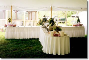 Table Setting for Buffet Reception | shaped buffet tables with floor-length banquet linens