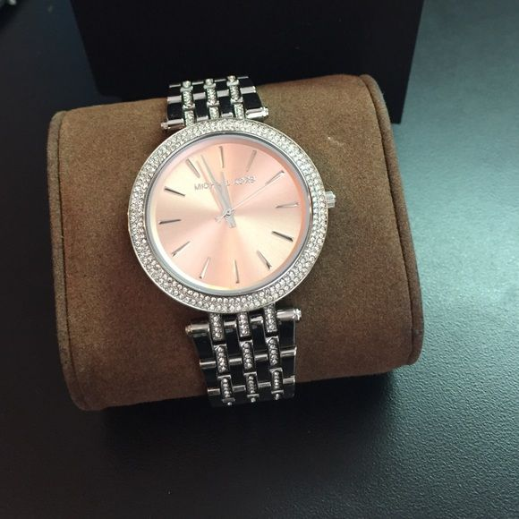 Michael Kors Darci Silver Pink Face Watch Worn less than 5 times. Comes with two additional links. Pristine condition!! Michael Kors Jewelry