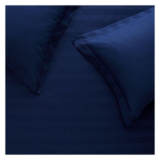 The luxurious Hotel blue waffle detail double duvet set is a crisp, classic design in embroidered Egyptian cotton.[br]Egyptian cotton's longer fibre length produces a fine yarn and a superior fabric that is smooth and soft, becoming softer with every wash.[br]The set comprises a duvet cover and 2 pillowcases and is also available in other colours and sizes.