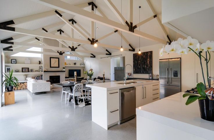Arthur's Point House   Exposed trusses, interior architecture, black and white living, black and white trusses, white polished concrete floor, open plan living space, family friendly interior design   NZ Homes   Build me.   www.buildme.co.nz  