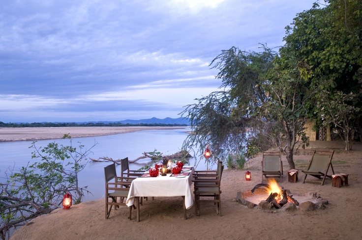 Sundowners and private dinners on the banks of the Luangwa River.