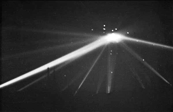 """Antiaircraft fire over Los Angeles, CA, 24-25 February 1942, during the """"Battle of Los Angeles."""" False reports of enemy planes (actually a rogue weather balloon) lead to firing of antiaircraft guns; 5 civilians died from resulting car accidents or heart attacks. (California State Archives)"""
