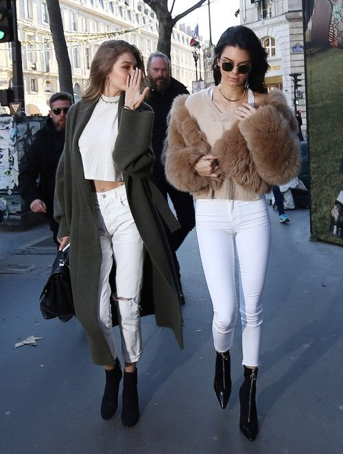 Gigi Hadid and Kendall Jenner out in Paris, France 11/28/ 2016 Her Versace handbag is not available online! Her Nili Lotan coat here ! ($1,350) Her Citizens of Humanity pants here! ($268) Her Gianvito Rossi booties here! ($1,165)