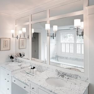 Hamilton Snowber Architects - bathrooms - marble counter, marble countertop, dual sinks, double vanity, white vanity, white bathroom vanity, his and hers sink, drop-down make-up vanity, built-in make-up vanity, polished nickel hardware, built-in mirror, inset sconces, polished nickel sconces, batten and board, drop-in tub, marble bath surround, faucet with shower head, white shutters, shutters, his and her vanities, his and her bathroom vanities,