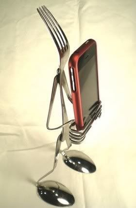 e39b5e96b5dc993ea8154d7442343c78 iphone stand made from cutlery. I want Bill to make this!