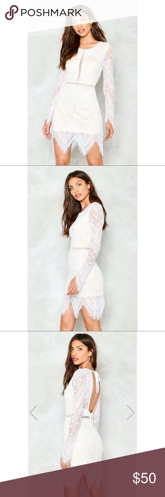 Nast Gal White Lace Mini Dress Nasty Gal One More Night Lace Mini Dress in white. Absolutely gorgeous dress! Scoop neck, open back, long sleeved. Very flattering. Brand new! Runs slightly small. Nasty Gal Dresses