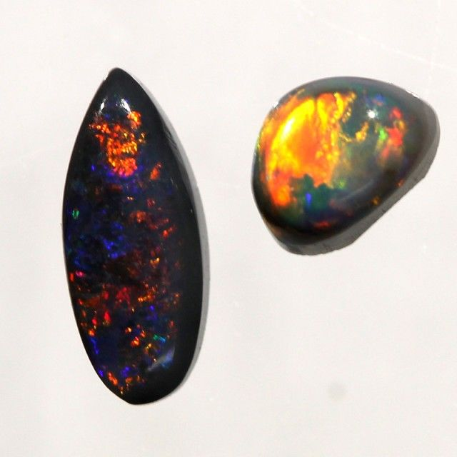 Australian Black Opal | Beautiful Australian black opal from Lightning Ridge, NSW. These stones are all 100% real and solid. Black opal refers to the body colour of the opal. In this case it is a dark black colour with play of colour on top. Note: These stones are small but bright
