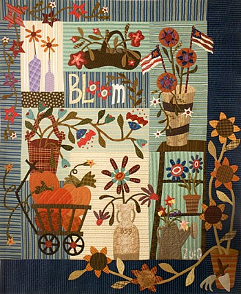 This would be fun to make - especially the sunflowers on the border - might have to use that idea on a quilt I'm designing now for my daughter!!