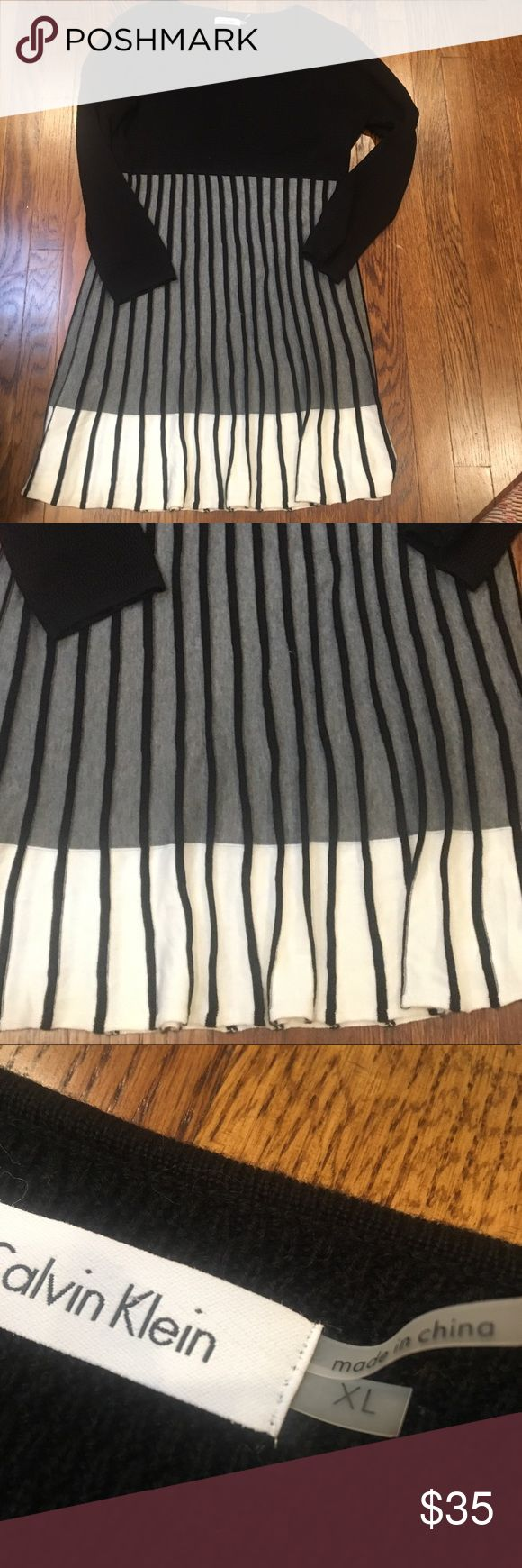CALVIN KLEIN KNIT DRESS w TRUMPET SKIRT SZ XL A great staple for fall and winter this black, gray, and white Calvin Klein knit dress with trumpet skirt is perfect for work or even casual settings. Chest: 44 inches,  waist 44 inches; length from the front scope neck 32 inches. Calvin Klein Dresses Mini