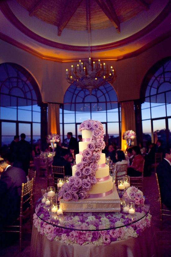 love this cake and the cake table. flower petals and candles on the cake table are a must