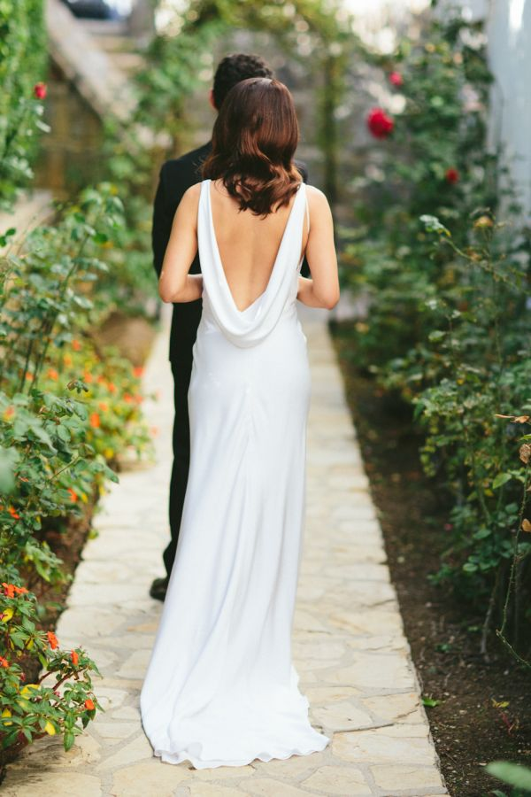 Elegant cowl back wedding gown: http://www.stylemepretty.com/2016/03/02/bel-air-ballroom-wedding-with-shades-of-green/ | Photography: Paige Jones - http://paigejones.us/