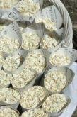 Ebony and ivory.....Recycled music sheet confetti cones with ivory larkspur petal confetti.
