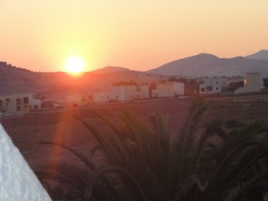 THE SUN IS RISING FROM THE MAGNIFICENT TALEA MOUNTAINS FROM ''STELLA BEACH'' BALCONY IN PANORMOS,CRETE ISLAND