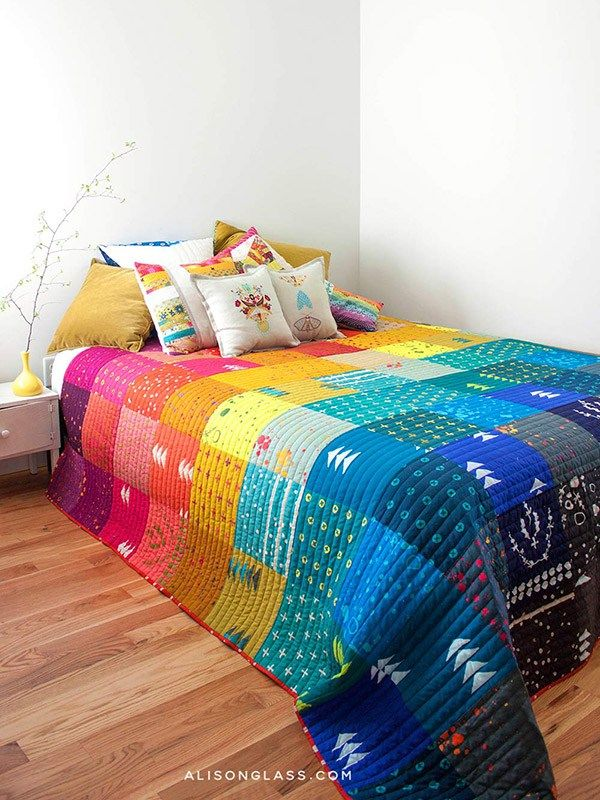 Handcrafted quilt by Alison Glass. A beautiful rainbow collection of all of the Handcrafted fabrics to date, from 2014-2016. Handcrafted by Alison Glass is modern line of batik fabrics. Hand stamped, hand dyed, one piece at a time, each bit of fabric is completely unique from the next, adding to the beauty.