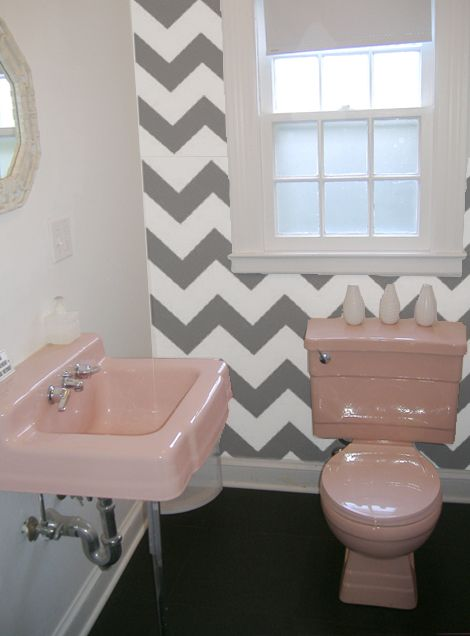 trying to figure out what to do with our pink bathroom...