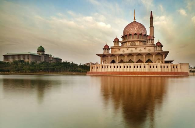 Putra Mosque- Malaysia Putra Mosque is the principal mosque of Putrajaya. It is located next door the the Malaysian Prime Ministers office. It is known for its pink dome, constructed with rose tinted...