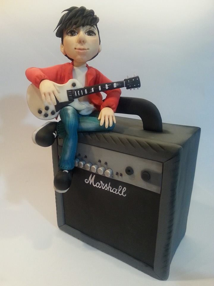Mary Torte - Boy with guitar sitting on amplifier