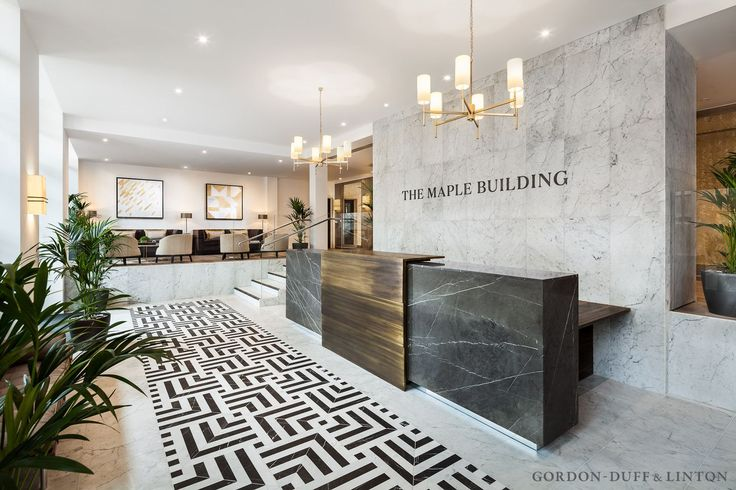 Reception area of the Maple Building. Bespoke Carrara and grey marquina marble floor tiles. Bespoke grey marquina reception desk with bronze wrap detail. Mezzanine area with B&B Italia seats and marble coffee tables. #GD&LBespoke