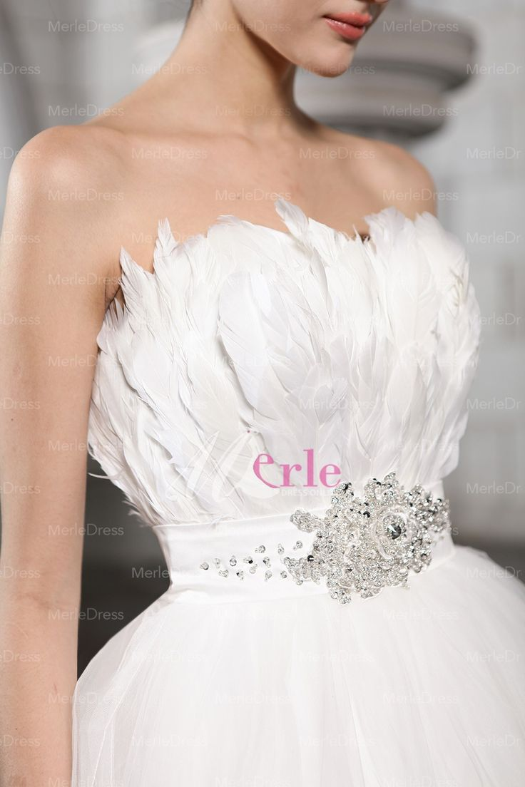 wedding dress with feather bodice strapless sleeveless beading feather chapel train net