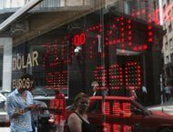 The board of an exchange house in downtown Buenos Aires reads the rate of 7.40 Argentine pesos to one dollar, sale rate and 7.10 to buy, on ...