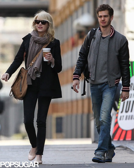 Emma Stone and Andrew Garfield Grab a Bite in the Big Apple: Emma Stone waved after getting breakfast with her boyfriend, Andrew Garfield, in NYC.   : Emma Stone carried a coffee in NYC.  : Emma Stone and Andrew Garfield strolled through NYC together on Tuesday.