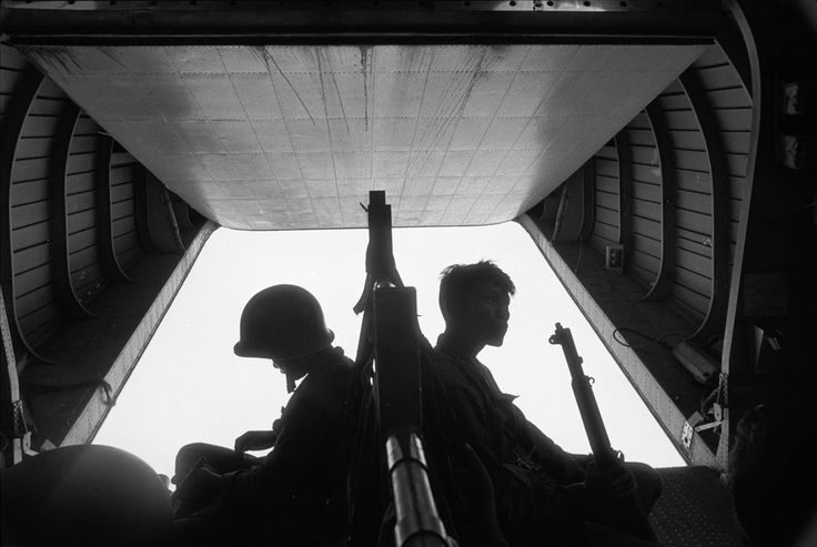 Rene Burri. VIETNAM. Mekong Delta. Near Tan Hung Dong. Airlift of South Vietnamese second company troops to an area where several hundred Vietcongs soldiers are supposed to be. 1963