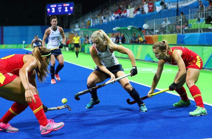 Great Britain forward Sophie Bray battles for the ball with Spain defender Xantal Gine and forward Alicia Magaz during the women's field hockey quarterfinals. - Best images from Aug. 15 at the Rio Olympics: 2016