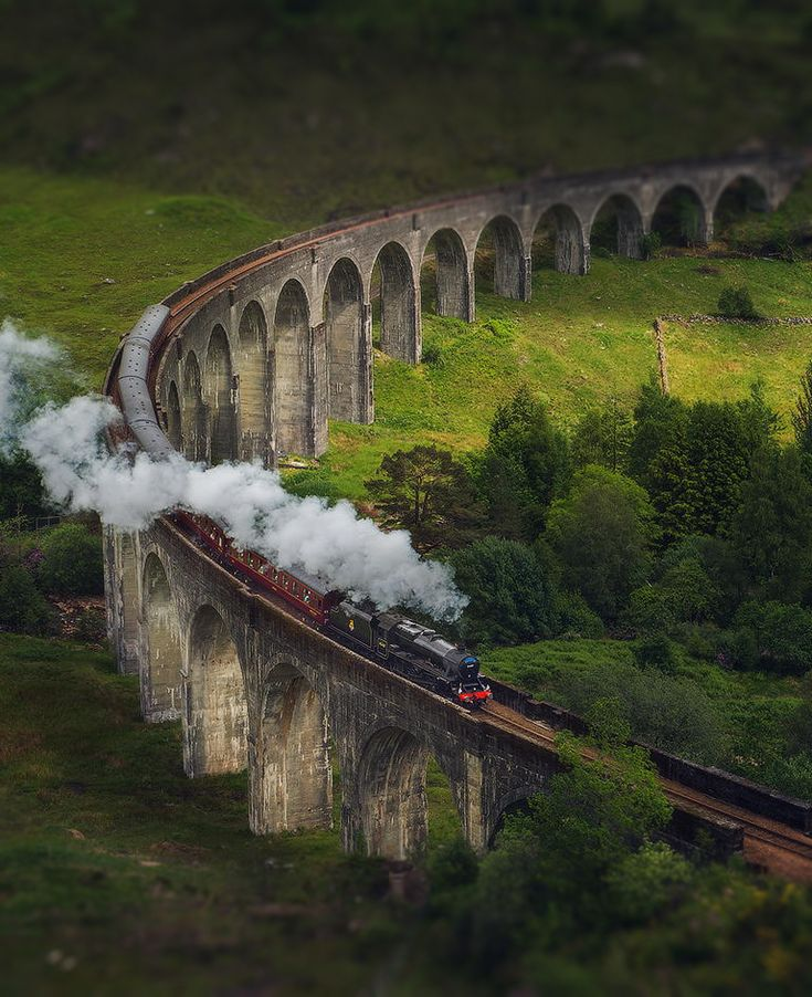 'Hogwarts Express' passing through the Glenfinnan Viaduct, Scotland