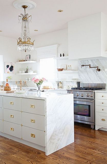 Dreamy marble kitchen with campaign style drawers