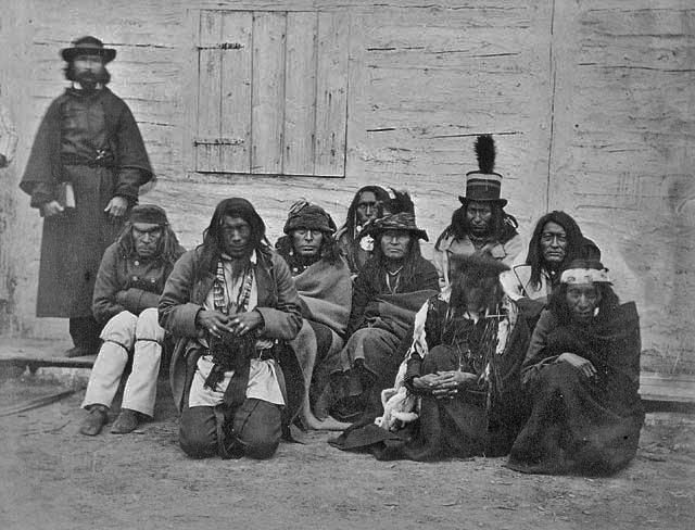 Cree men including Big Bear (wearing a plumed Top Hat) at Rocky Mountain House in Alberta - 1871