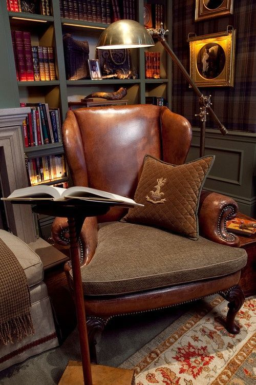 Plaid wallpaper, harris tweed, a wing back chair, and books. Man your talking my language…