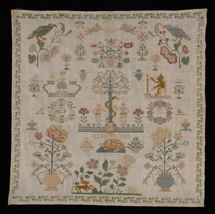 """Merklap gewerkt in kruissteek in gekleurd zijde op crèmekleurig katoen met linneneffect, gemerkt """"MLB / 1781"""""""