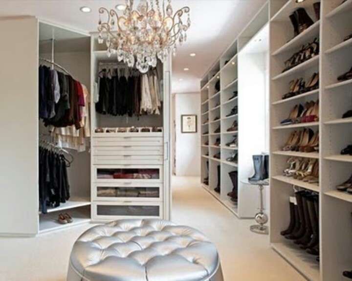 Walk in closet idea- thin drawers for jewelry.  No master suite is complete without a walk-in closet.  This one is ahhh-maze-ing!!  Love the chandelier and ottoman seating!