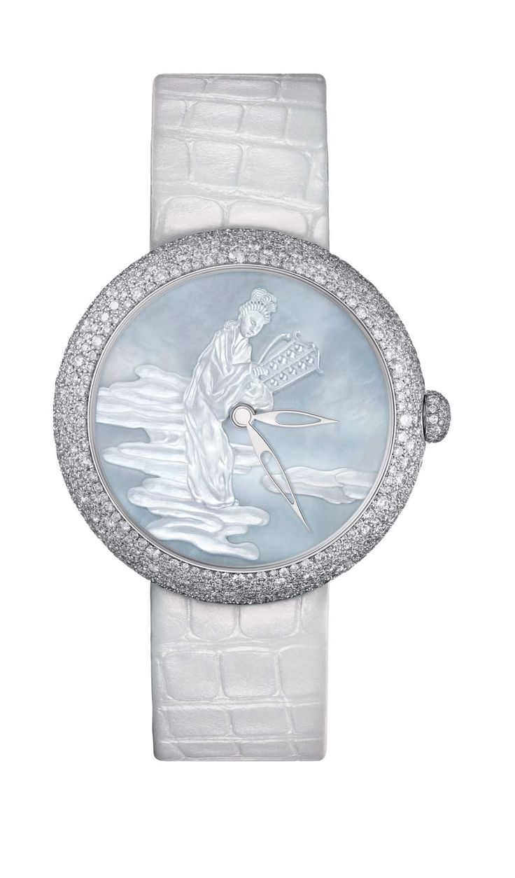 Chanel Mademoiselle Privé Coromandel watch in white gold, one of two watches that form the Coromandel Dial Set, with a sculpted mother-of-pearl dial, snow-set with diamonds.