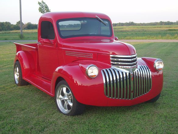 1946 Chevy Short Bed. Who doesn't want a shiny red truck?