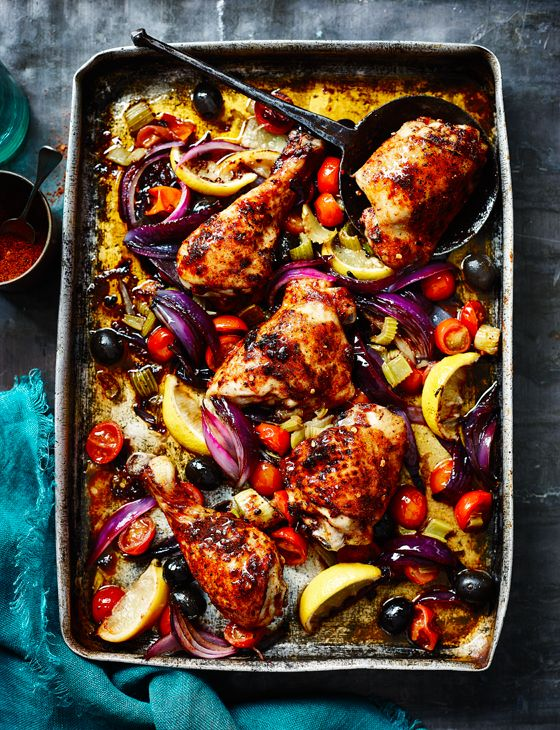 Harissa-spiced chicken legs roasted with lemons, tomatoes and celery - Sainsbury's Magazine